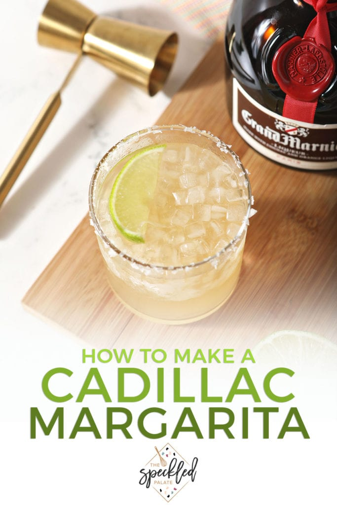 A margarita garnished with a lime sits next to a bottle of Grand Marnier with the text 'how to make a cadillac margarita'