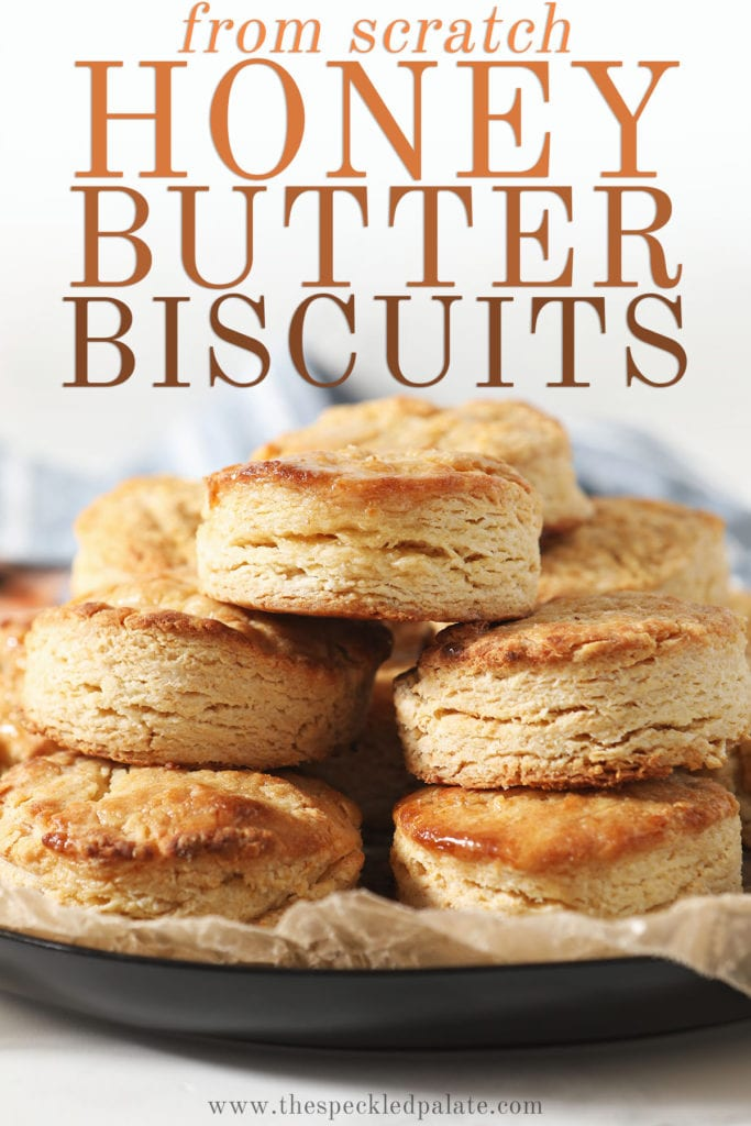 A stack of honey biscuits on a plate with text saying from scratch honey butter biscuits