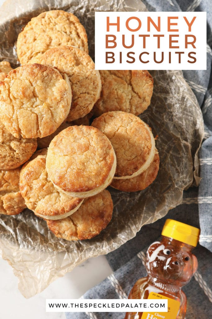 A plate of biscuits next to a honey bottle with the text honey butter biscuits