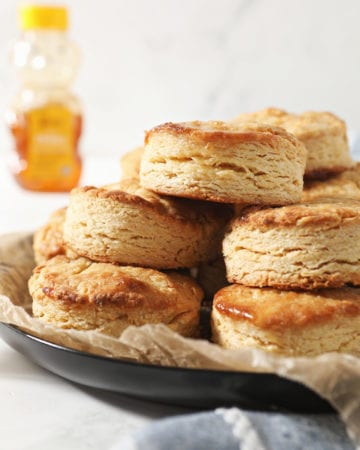 A stack of honey biscuits on a plate