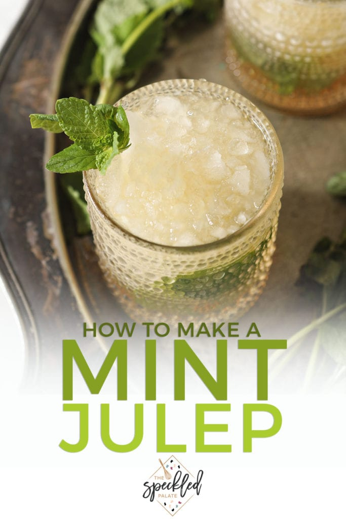 A mint julep garnished with mint on silver with the text 'how to make a mint julep'