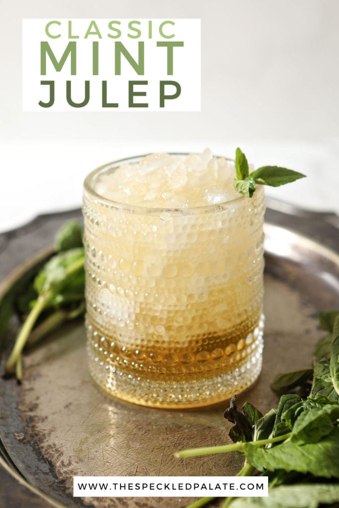 A mint julep with a mint sprig on a silver tray with the text 'classic mint julep'