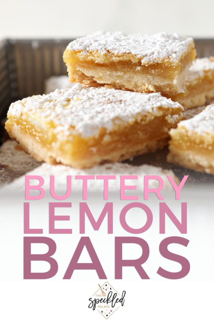 Stacked lemon bars with the text buttery lemon bars