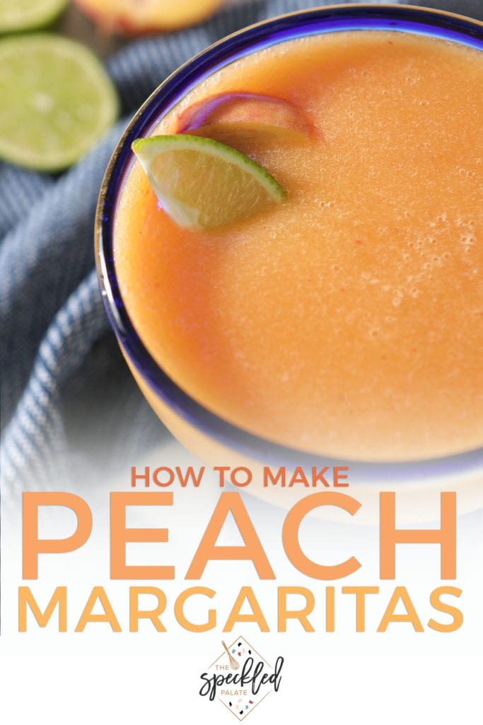 A peach margarita in a blue-rimmed glass with lime and peach wedges with text how to make peach margaritas