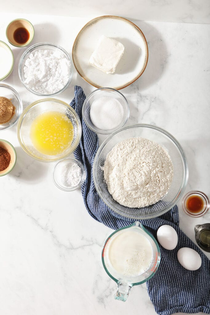 Homemade pancake recipe ingredients in bowls on a marble countertop