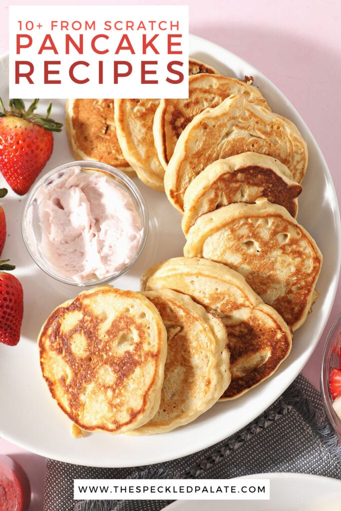 A white plate holds pancakes with strawberries and whipped cream with the text 10+ from scratch pancake recipes