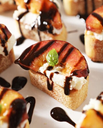 Close up of a Ricotta Crostini with a Grilled Peach