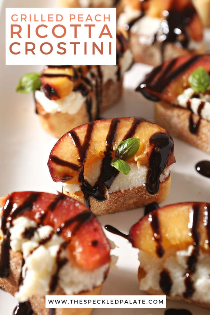 Several peach crostini on a white tray with the text grilled peach ricotta crostini