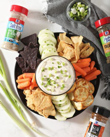 A platter of dippers with an easy dip recipe on marble