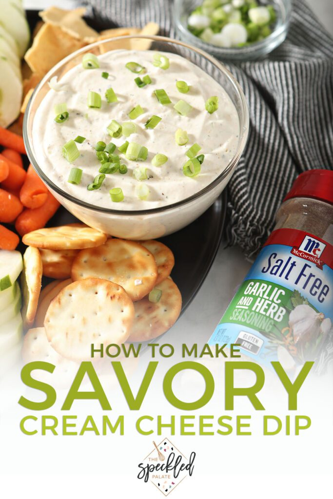 A bowl of Garlic and Herb Cream Cheese Dip with dippers with the text how to make savory cream cheese dip