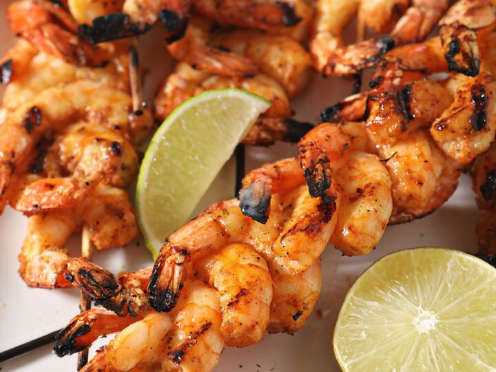 Skewers of shrimp on a white plate