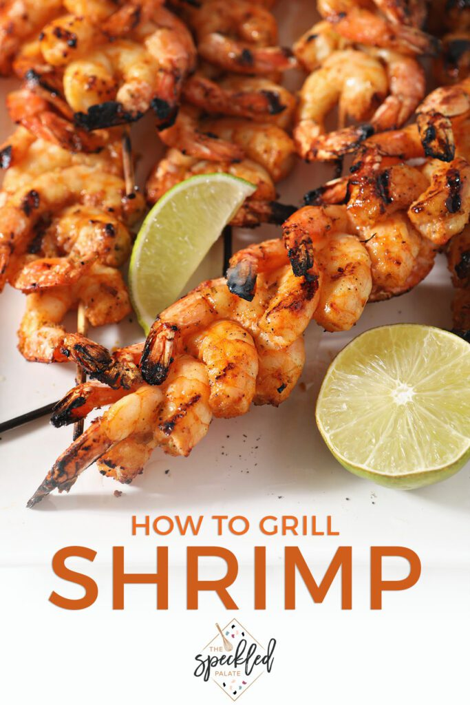 Shrimp skewers with lime wedges on a white plate with the text how to grill shrimp
