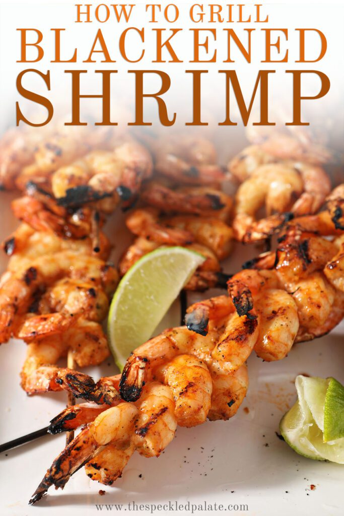 Skewers of shrimp on a white plate with the text how to grill blackened shrimp
