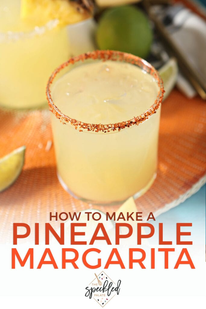 A tajin-rimmed margarita with the text how to make a pineapple margarita