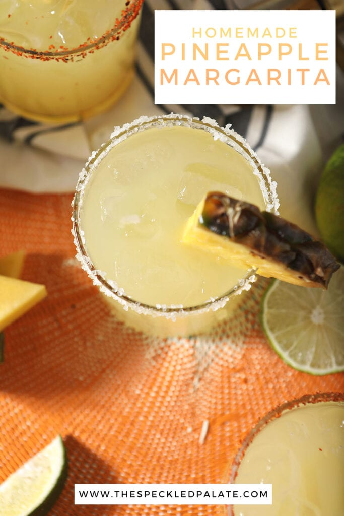 Close up of a margarita with a pineapple wedge with the text homemade pineapple margarita
