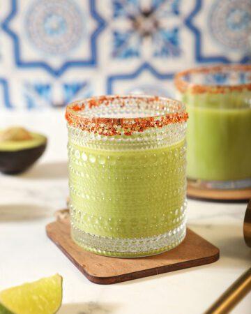 Two Avocado Margaritas on wood coasters