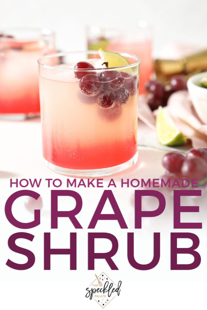 A drink garnished with a lime wedge and grapes with the text how to make a homemade grape shrub