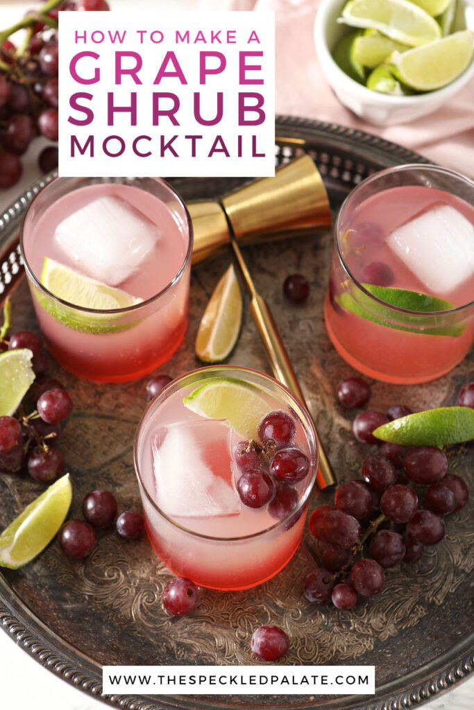 Three glasses of a pink drink on a tray with the text how to make a grape shrub mocktail