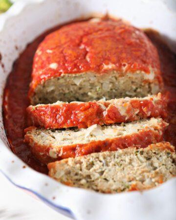 Sliced Italian Chicken Meatloaf in a roasting pan