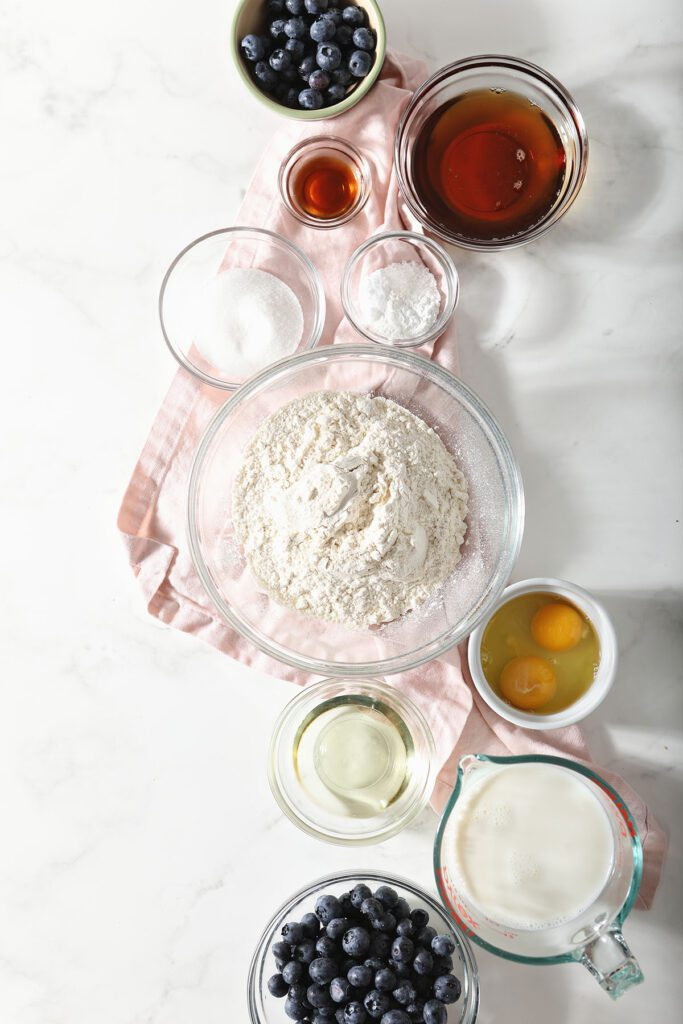 Pancake ingredients in bowls on marble
