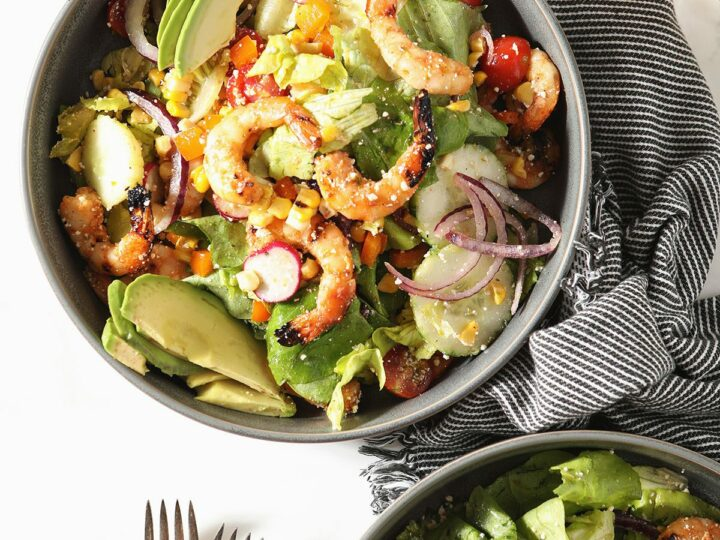 Two bowls of grilled shrimp salad with lime vinaigrette
