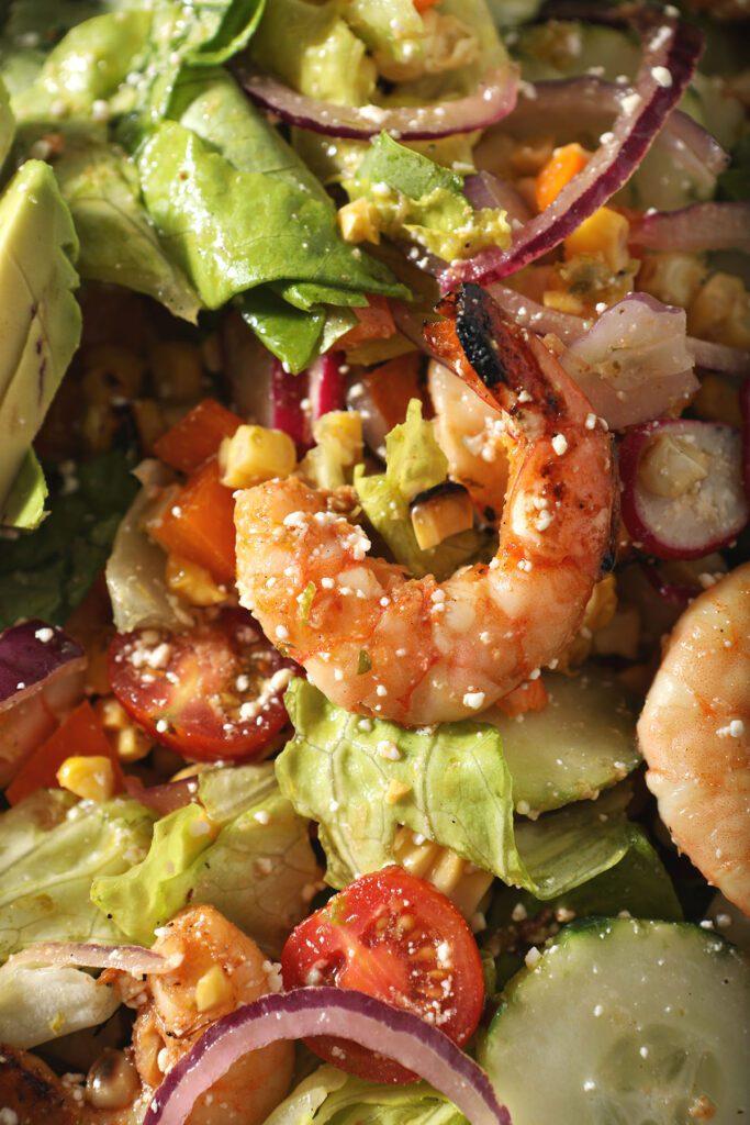 Close up of grilled shrimp on salad