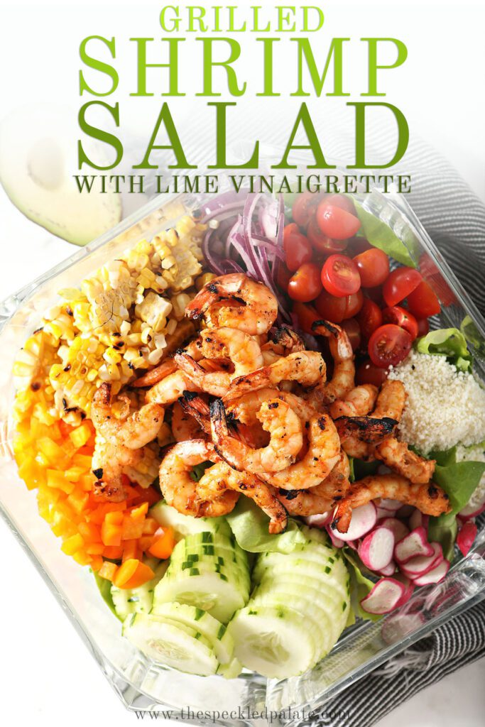 Colorful salad ingredients in a bowl with the text grilled shrimp salad with lime vinaigrette