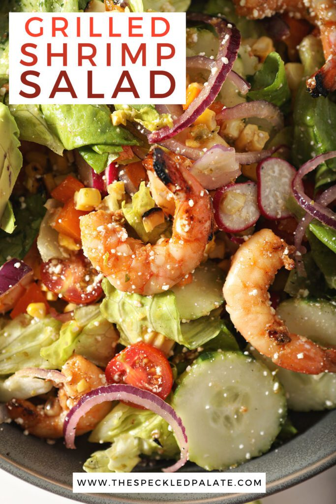 Close up of shrimp on a salad with the text grilled shrimp salad