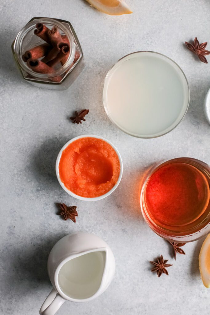 Ingredients for a pumpkin spice cocktail in bowls