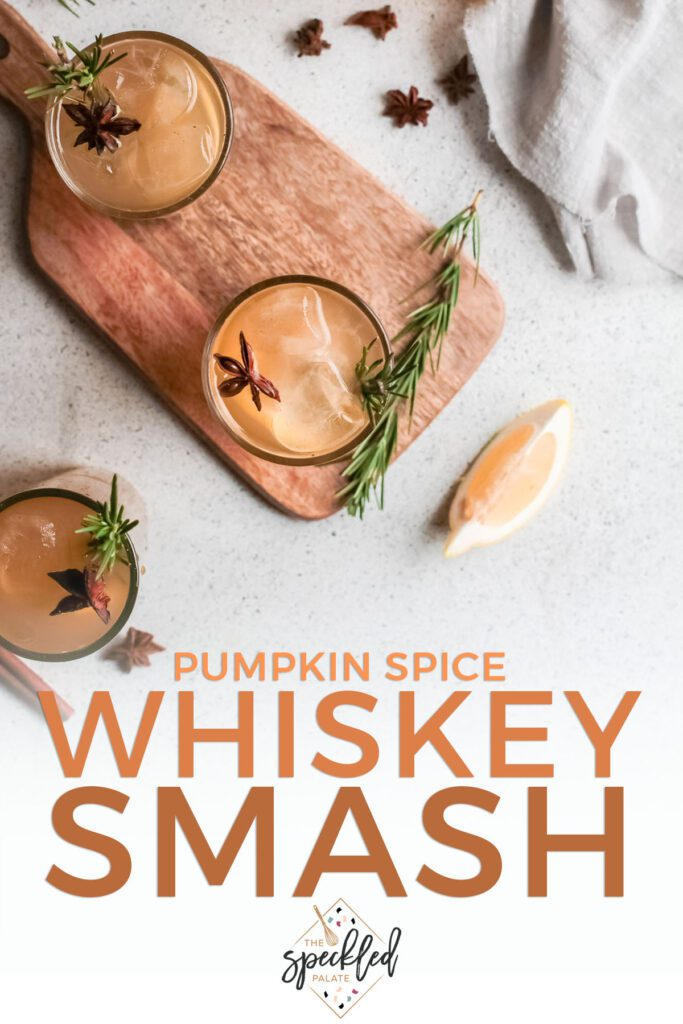 Three glasses of orange liquid from above with rosemary and star anise with text pumpkin spice whiskey smash