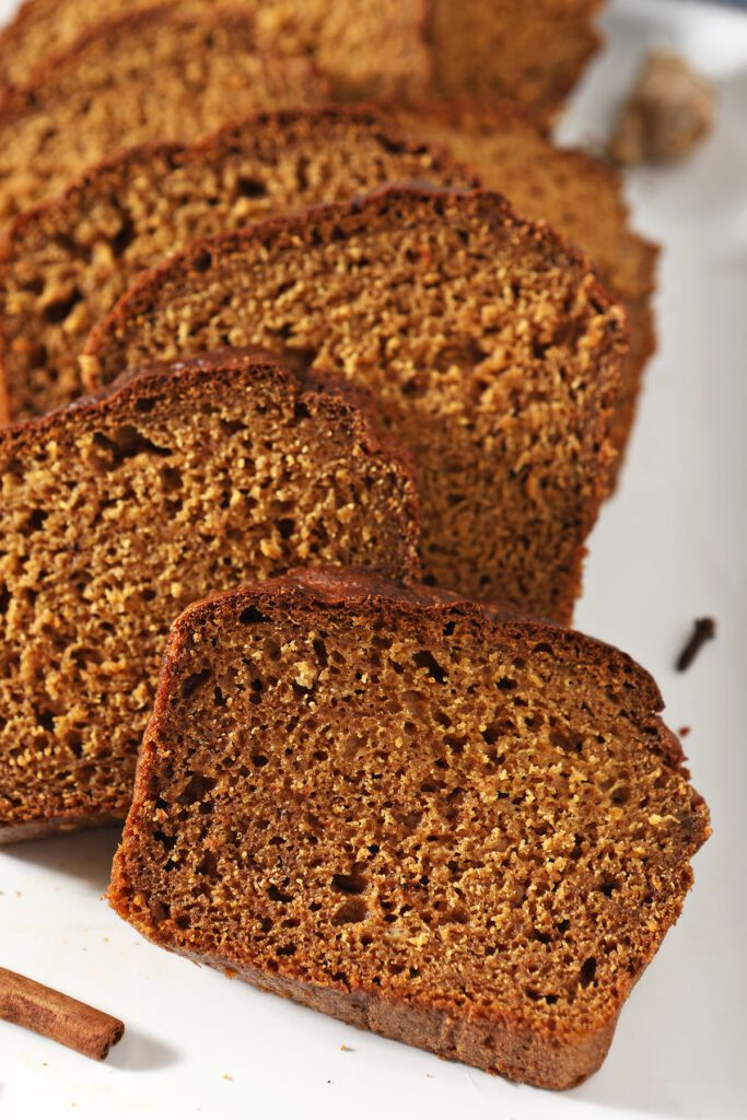 Close up of slices of Pumpkin Spice Bread on a white tray