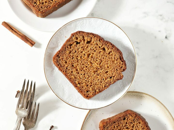 Slices of pumpkin bread on white plates