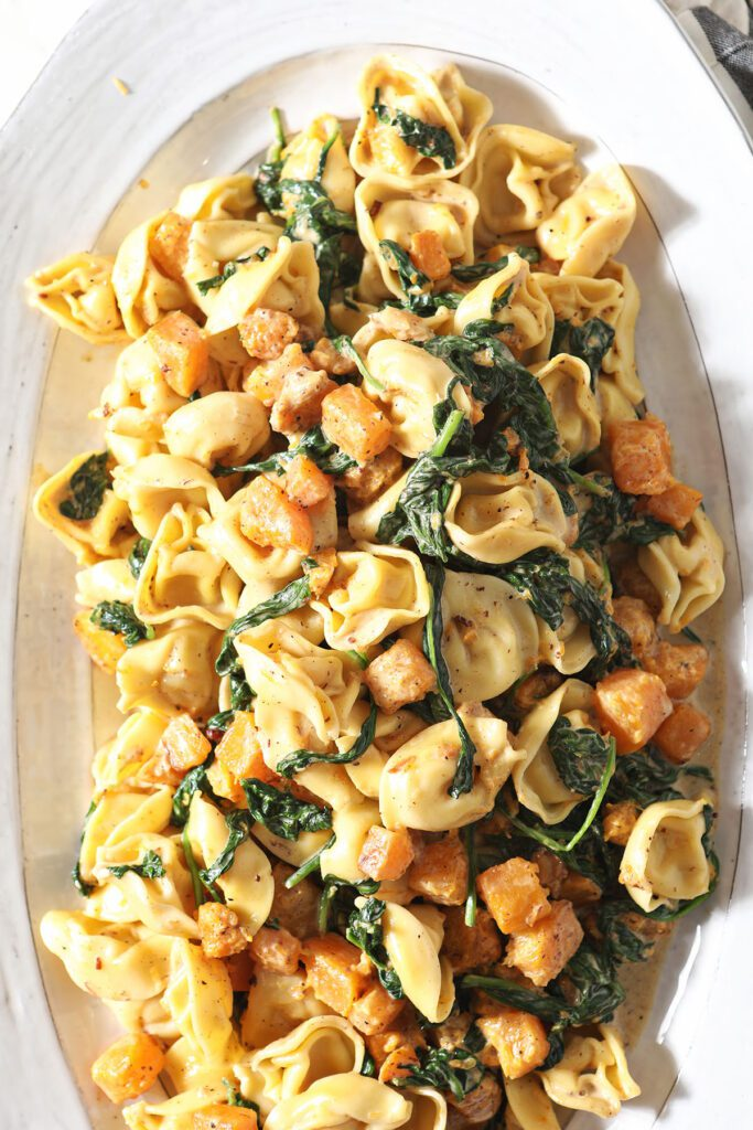 Tortellini Butternut Squash Pasta with Pancetta and Spinach on a large white serving platter