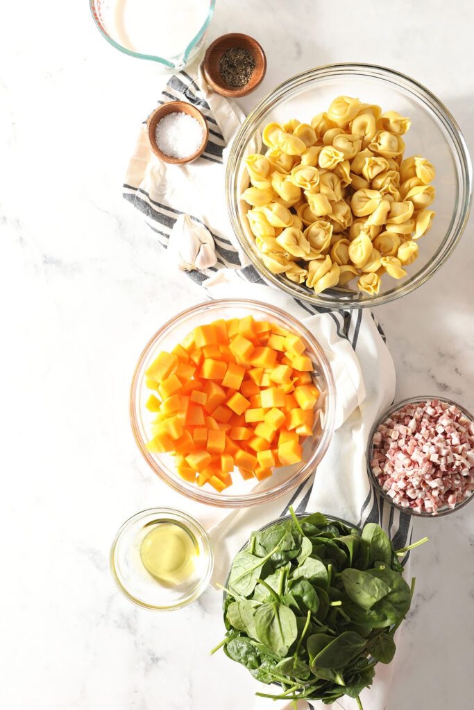 Butternut squash, pasta and other ingredients in bowls